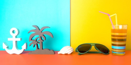 summer decoration object with orange juice drink on colorful pap